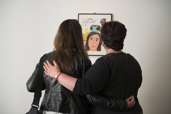 Bronwen, one of the young artists and her mother viewing Bronwen's painting