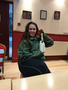 Heather Petrie from Bolt Burdon Kemp with a bottle of champagne
