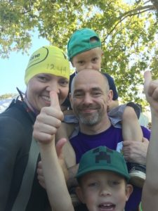 Alex Dabek from Bolt Burdon Kemp with family before the Swim Serpentine Challenge