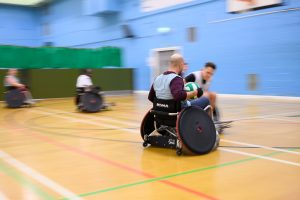 Ahmed Al-Nahhas in wheelchair with ball