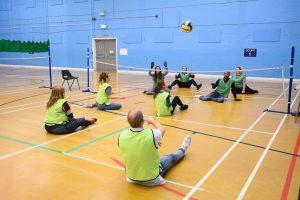 Bolt Burdon Kemp teams playing sitting volleyball
